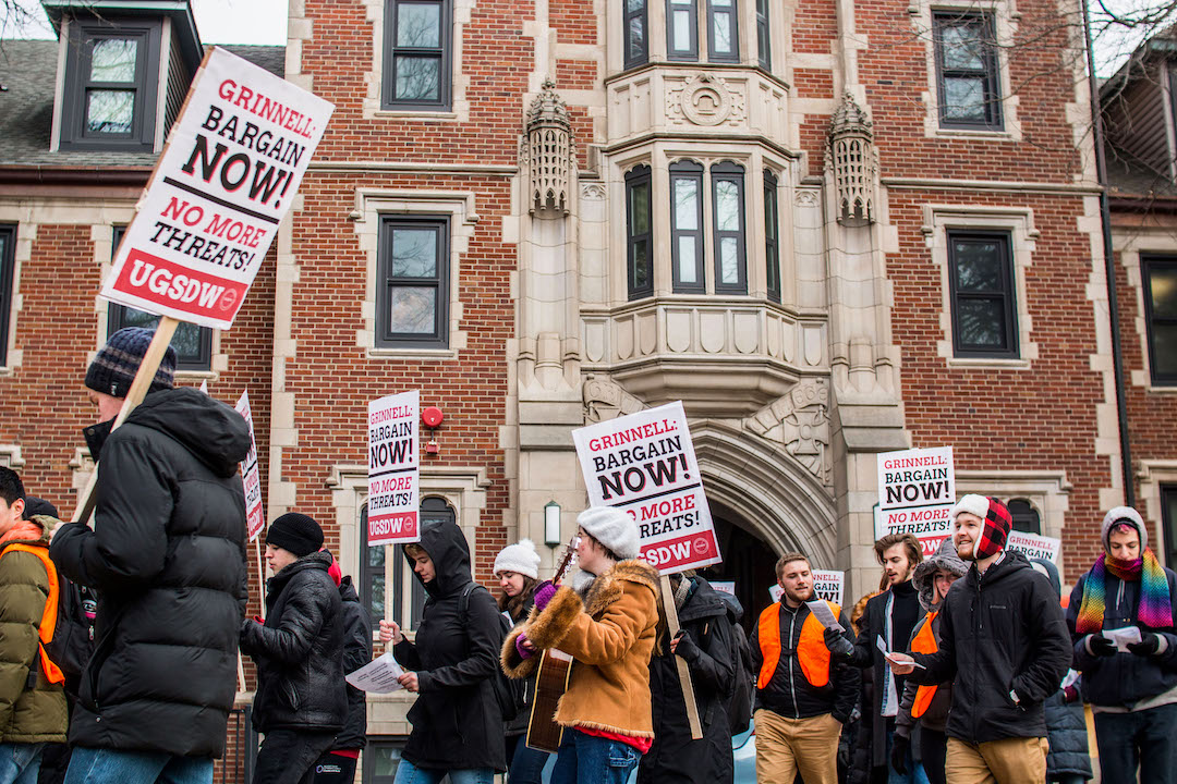 UGSDW members march to protest Grinnell's actions